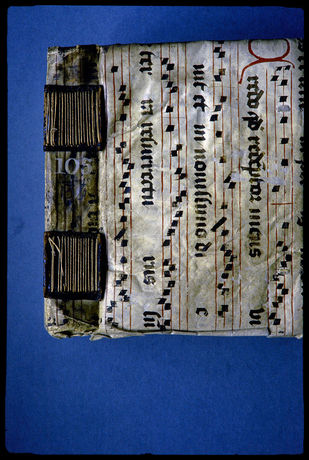 15th century longstitch binding with separate pierced supports and a cover of manuscript waste taken from a discarded liturgical book