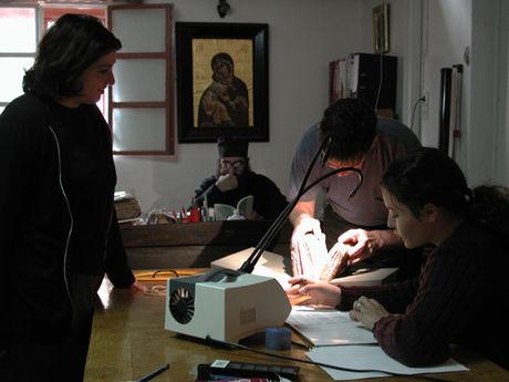 The team discussing a manuscript