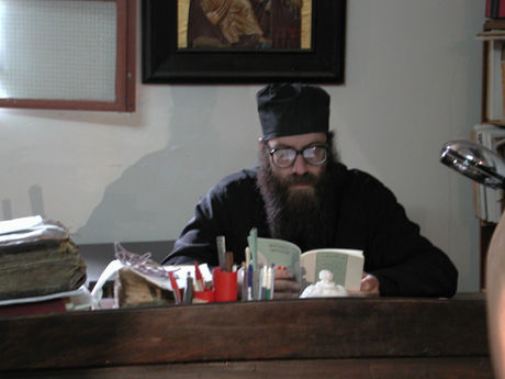 Father Grigorios counting pages