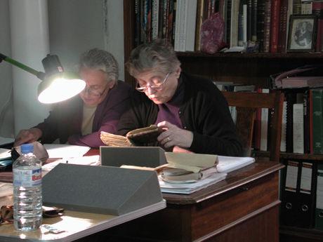 Two Georgian scholars reading thorough a Georgian mss