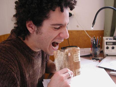 Nikolas Sarris pretending to eat a book