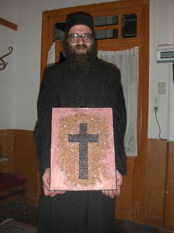 Father Grigorios holding his mosaic